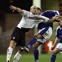 Clyde v St Johnstone..22.03.05<br />Simon Mensing pulled by David Hannah<br /><br />Picture by Graeme Hart.<br />Copyright Perthshire Picture Agency<br />Tel: 01738 623350  Mobile: 07990 594431