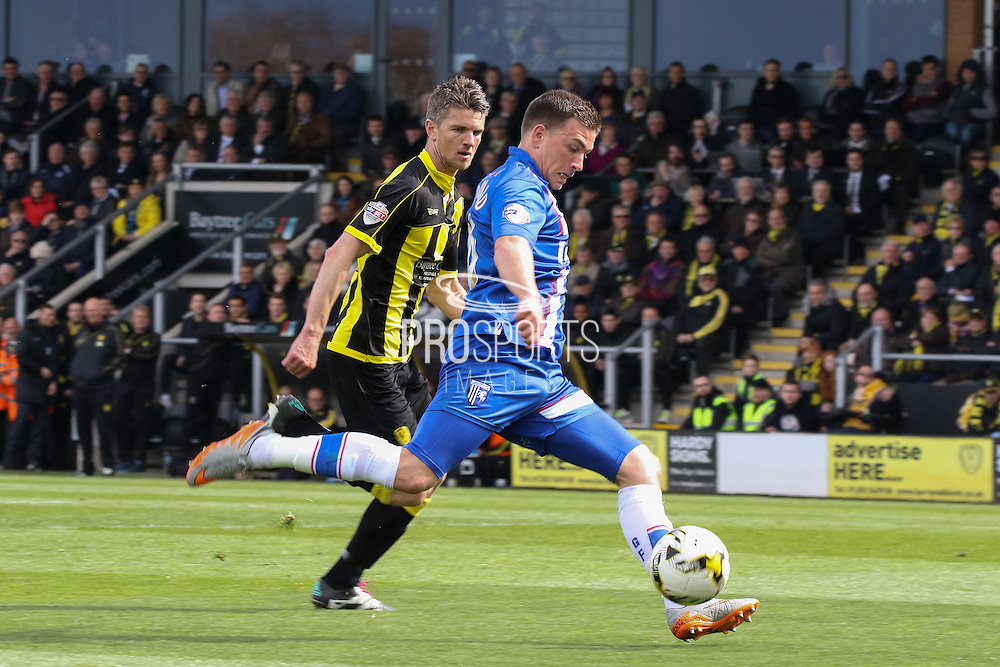 Gillingham forward Cody McDonald strikes at goal during the Sky Bet League 1 match between Burton Albion and Gillingham at the Pirelli Stadium, Burton upon Trent, England on 30 April 2016. Photo by Aaron  Lupton.