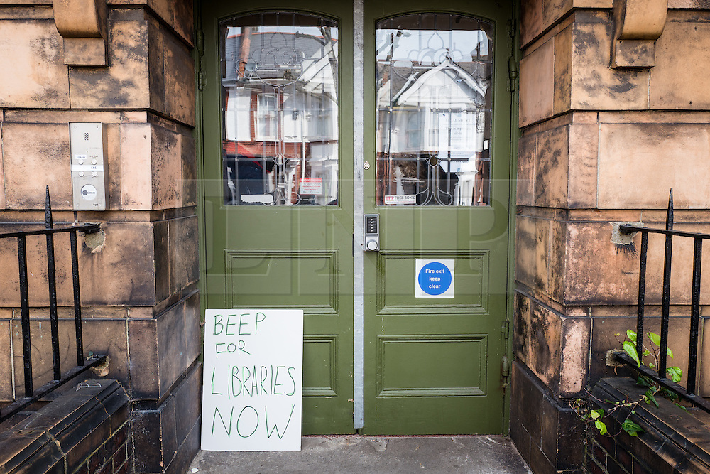 © Licensed to London News Pictures. 01/04/2016. London, UK. Protest signs left outside the Carnegie Library in Herne Hill, which is currently occupied bu local residents in an effort to prevent its closure. Lambeth Council had planned to close the library last night (31st March) in order to turn it into a 'healthy living centre'. Photo credit : Rob Pinney/LNP