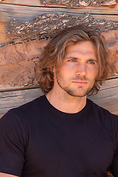 hot man with long brown hair and blue eyes