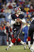 Bills quarterback Drew Bledsoe drops back to pass during a 20 to 3 win by the Miami Dolphins over the Buffalo Bills in an NFL Week 16 game in Buffalo on December 21, 2003. Drew was sacked six times while completing only 12 of 24 passes with one interception and no touchdowns. ©Paul Anthony Spinelli