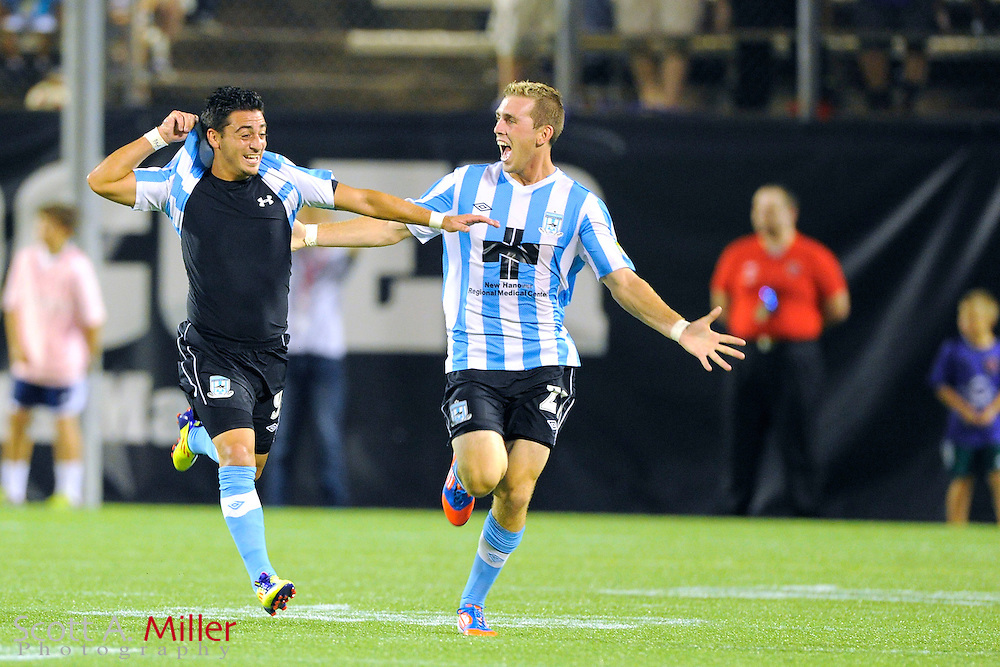 Wilmington midfielder Hagop Chirishian (9) celebrates with forward Corey Hertzog (21) after scoring during the Hammerheads 4-3 USL-Pro playoff win over the Orlando City Lions at the Florida Citrus Bowl on August 31, 2012 in Orlando, Florida. ..©2012 Scott A. Miller.