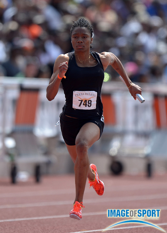 Mar 29, 2014; Austin, TX, USA; Michelle Lee Ahye runs a leg in the womens 4 x 100m relay in the 87th Clyde Littlefield Texas Relays at Mike A. Myers Stadium.