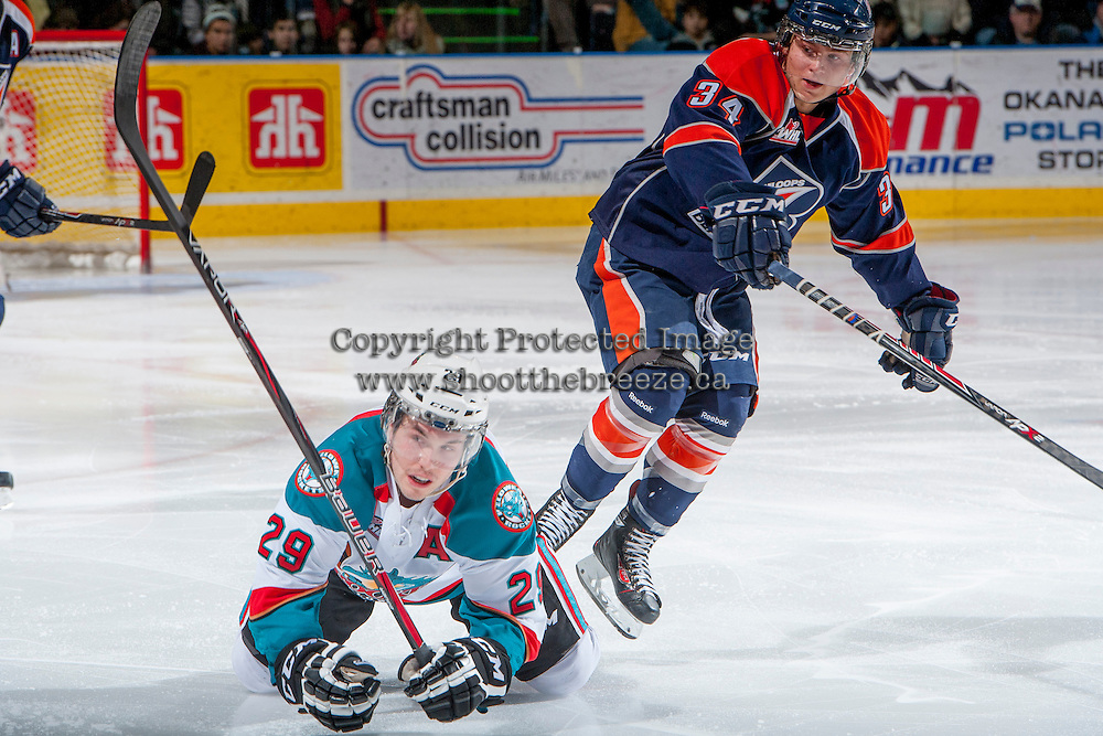 KELOWNA, CANADA - DECEMBER 27: Mitch Lipon C #34 of the Kamloops Blazers checks Myles Bell #29 of the Kelowna Rockets on December 27, 2013 at Prospera Place in Kelowna, British Columbia, Canada.   (Photo by Marissa Baecker/Shoot the Breeze)  ***  Local Caption  ***