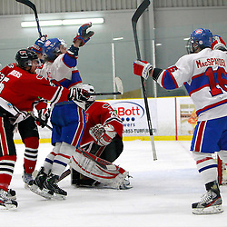 TORONTO, ON - Feb 16 : Ontario Junior Hockey League Game Action between the Milton Ice Hawks and the Toronto Jr. Canadiens, Anthony Repaci #78 of the Toronto Jr. Canadiens Hockey Club celebrates the goal while being cross checked by Troy Saunders #5 of the Milton Ice Hawks Hockey Club during third period game action.<br /> (Photo by Brian Watts / OJHL Images)