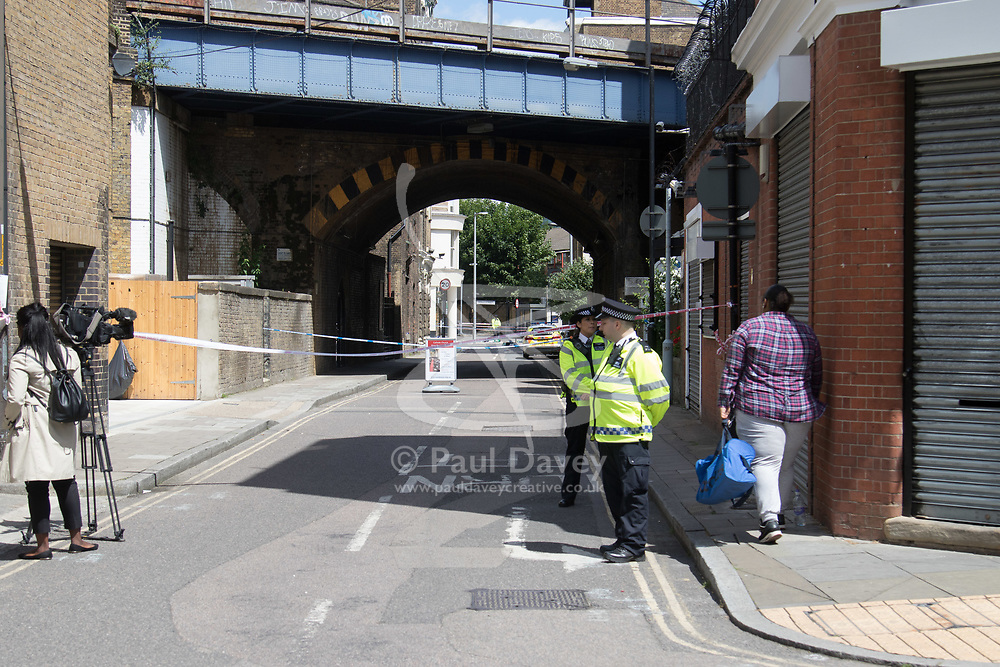 London, June 4th 2017. Police man a barrier during a massive policing operation in the aftermath of the terror attack on London Bridge and Borough Market on the night of June 3rd which left seven people dead and dozens injured