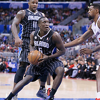 06 January 2014: Orlando Magic shooting guard Victor Oladipo (5) drives past Los Angeles Clippers center DeAndre Jordan (6) during the Los Angeles Clippers 101-81 victory over the Orlando Magic at the Staples Center, Los Angeles, California, USA.