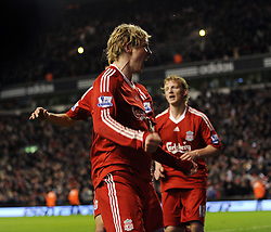 Liverpool's Spanish forward Fernando Torres celebrates after scoring his team's second goal during their Premier league football match against Chelsea at Anfield in Liverpool, north-west England, on February 1, 2009. Liverpool won the match 2-0.