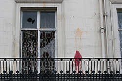 © licensed to London News Pictures. London, UK 04/02/12. Police guard the embassy which has broken windows and paint on the walls. Fresh protests are taking place outside the Syrian embassy in London amid reports that over 200 people were killed by shelling in the country. Photo credit: Tolga Akmen/LNP
