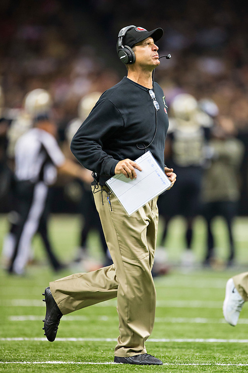 NEW ORLEANS, LA - NOVEMBER 9:  Head Coach Jim Harbaugh of the San Francisco 49ers jogs onto the field to check on a injured player during the third quarter of a game against the New Orleans Saints at Mercedes-Benz Superdome on November 9, 2014 in New Orleans, Louisiana.  (Photo by Wesley Hitt/Getty Images) *** Local Caption *** Jim Harbaugh