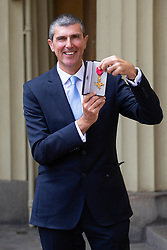 England Women's cricket team coach Mark Robinson OBE displays his award after his investiture by HM The Queen at Buckingham Palace. London, June 01 2018.