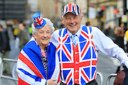 Spectators adorned in Union flag-liveried clothing during the Manchester Olympic Parade in Manchester, United Kingdom on 17 October 2016. Photo by Richard Holmes.