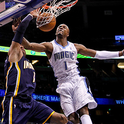 March 11, 2012; Orlando, FL, USA; Indiana Pacers shooting guard Dahntay Jones (1) dunks over Orlando Magic shooting guard Von Wafer (1) during the fourth quarter of a game at  Amway Center. The Magic defeated the Pacers 107-94.  Mandatory Credit: Derick E. Hingle-US PRESSWIRE