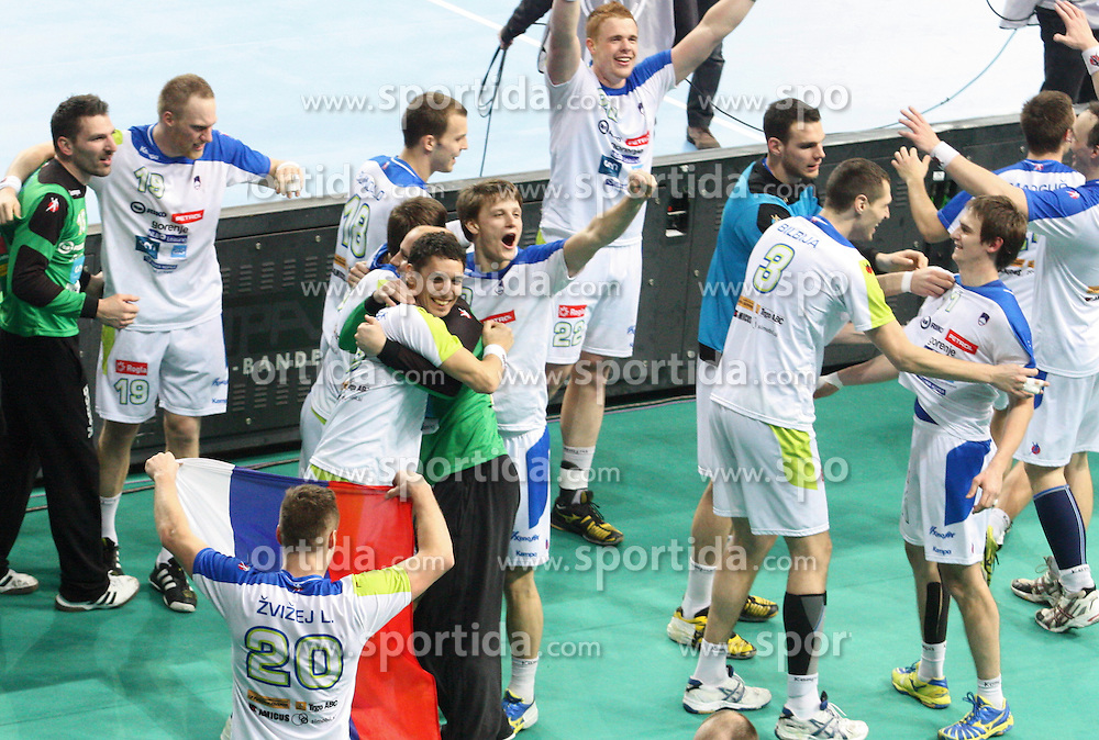 Players of Slovenia celebrate during the quarterfinal match of IHF World Championship Spain 2013 between Russia and Slovenia at Pabellon Principe Felipe Arena on January 23, 2013 in Barcelona, Spain. (Photo by Joma  Garcia / Sportida.com)