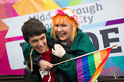 © Licensed to London News Pictures. <br /> 27/09/2014. <br /> <br /> Middlesbrough, United Kingdom<br /> <br /> A couple react to the camera during a parade in the centre of Middlesbrough which was part of a Pride event that brings together many members of the Lesbian, Gay, Bisexual and Transgender community from the area.<br /> <br /> Photo credit : Ian Forsyth/LNP