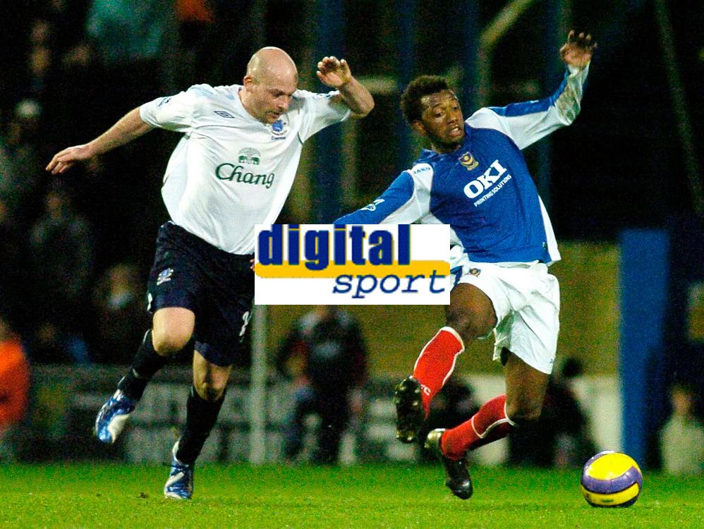 Photo: Gareth Davies.<br />Portsmouth v Everton. The Barclays Premiership. 09/12/2006.<br />Everton's Lee Carsley (L) pulls back Portsmouth's Manuel Fernandes (R).