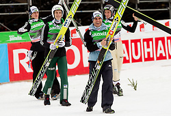 Third placed team of Slovenia: Peter Prevc, Jurij Tepes, Jernej Damjan and Robert Kranjec celebrate prior to the flower ceremony during Flying Hill Team at 3rd day of FIS Ski Jumping World Cup Finals Planica 2011, on March 19, 2011, Planica, Slovenia. (Photo by Vid Ponikvar / Sportida)