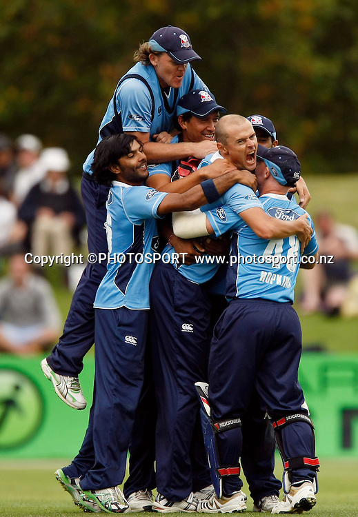 Auckland bowler Chris Martin after bowling the final over is surrounded by team mates as they celebrate their win. Canterbury Wizards v Auckland Aces in the One Day Competition Final. QEII Park, Christchurch, New Zealand. Sunday, 13 February 2011. Joseph Johnson / PHOTOSPORT.