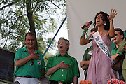 (from left) Roberto Calderoli, Minister of Normative Simplification of Berlusconi's cabinet, Umberto Bossi, Federal Secretary of Lega Nord (Northern League party), Zuleika Morsut, Miss Camicia Verde (green shirt) 2007, sing Va pensiero at Lega Nord meeting in Pontida, Sunday, June 14, 2009.