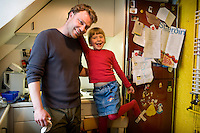 Gísli Hrafn Atlason (33) anthropologist with his daugher Þorbjörg (5) at home. Together in the kitchen just before making dinner.