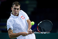 Jerzy Janowicz of Poland competes in single match during the BNP Paribas Davis Cup 2014 between Poland and Croatia at Torwar Hall in Warsaw on April 4, 2014.<br /> <br /> Poland, Warsaw, April 4, 2014<br /> <br /> Picture also available in RAW (NEF) or TIFF format on special request.<br /> <br /> For editorial use only. Any commercial or promotional use requires permission.<br /> <br /> Mandatory credit:<br /> Photo by © Adam Nurkiewicz / Mediasport