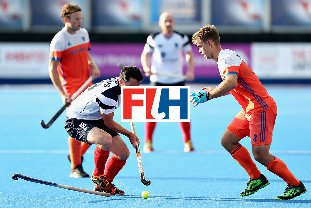 LONDON, ENGLAND - JUNE 17: Wei Adams of Scotland attempts to pass Tristan Algera of the Netherlands during the Hero Hockey World League Semi Final match between Scotland and Netherlands at Lee Valley Hockey and Tennis Centre on June 17, 2017 in London, England.  (Photo by Alex Morton/Getty Images)