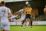 Cambridge United's Jevani Brown(20) clears this cross during the EFL Sky Bet League 2 match between Cambridge United and Milton Keynes Dons at the Cambs Glass Stadium, Cambridge, England on 13 October 2018.