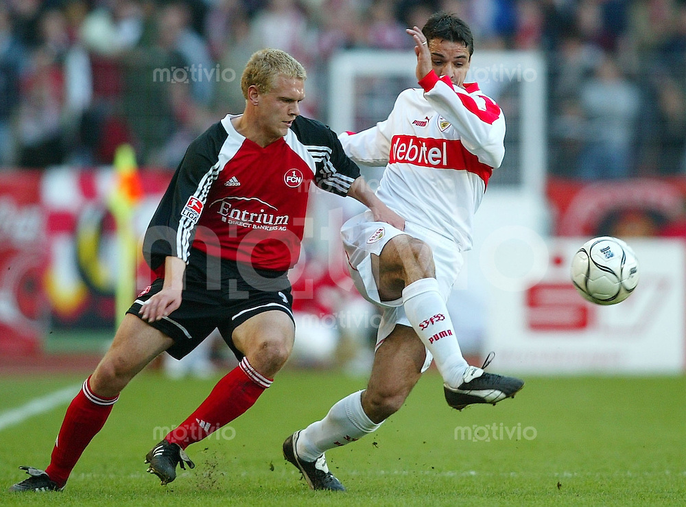 Fussball  1. Bundesliga Saison 2002/2003   26. Spieltag VfB Stuttgart - 1. FC Nuernberg 0:2          Andreas WOLF (links, Nuernberg) gegen Ioan Viorel GANEA (rechts, Stuttgart)