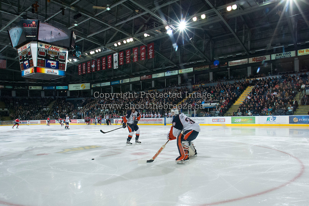 KELOWNA, CANADA - NOVEMBER 1:  Cole Cheveldave #38 of the Kamloops Blazers shoots the puck out of the zone against the Kelowna Rockets as the Kamloops Blazers visit the Kelowna Rockets on November 1, 2012 at Prospera Place in Kelowna, British Columbia, Canada (Photo by Marissa Baecker/Shoot the Breeze) *** Local Caption ***