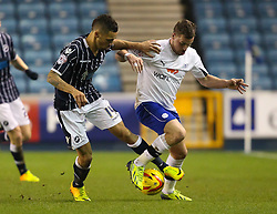 Millwall's Ryan Fredericks tussles for the ball with Sheffield Wednesday's Chris Maguire - Photo mandatory by-line: Robin White/JMP - Tel: Mobile: 07966 386802 28/01/2014 - SPORT - FOOTBALL - The Den - Millwall - Millwall v Sheffield Wednesday - Sky Bet Championship