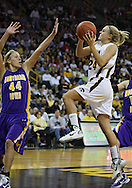 December 22 2010: Iowa guard Jaime Printy (24) puts up a shot over Northern Iowa guard/forward Erin Brocka (44) during the second half of an NCAA college basketball game at Carver-Hawkeye Arena in Iowa City, Iowa on December 22, 2010. Iowa defeated Northern Iowa 75-64.