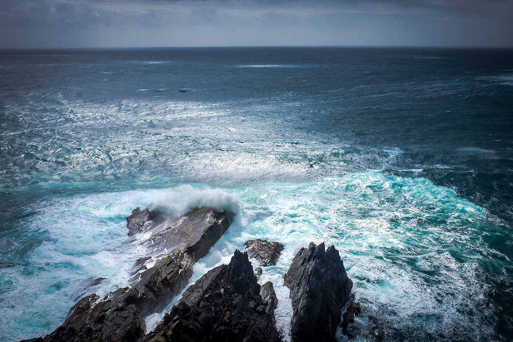 Atlantic Waves breaking on the rocky coast, at Mizen Head, Cork, Ireland