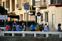 MALTA GOZO MARSALFORN 25JUL06 - Maltese people wait for the bus at Marsalforn bus stop in the early morning hours...jre/Photo by Jiri Rezac..© Jiri Rezac 2006..Contact: +44 (0) 7050 110 417.Mobile:  +44 (0) 7801 337 683.Office:  +44 (0) 20 8968 9635..Email:   jiri@jirirezac.com.Web:    www.jirirezac.com