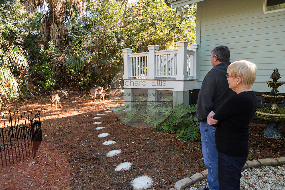 HSUS Immunocontraception Program Manager Rick Naugle and Linda Freeman view deer in her yard on Fripp Island, SC.