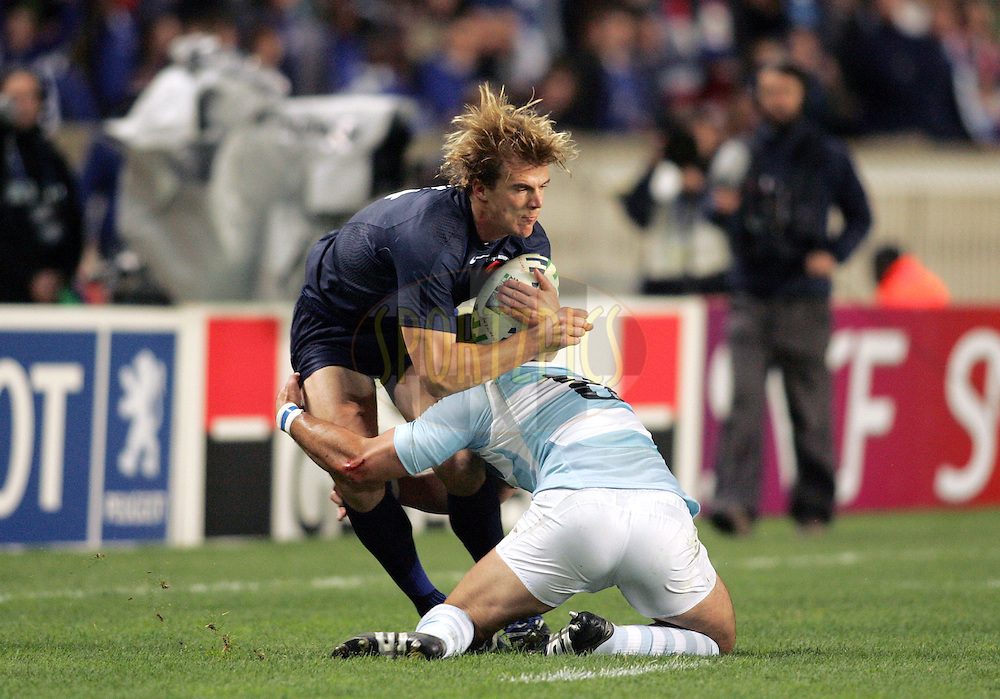Rugby World Cup, France v Argentina, 19 October 2007. Remy Martin is caugh in the tackle at the Parc des Princes, Paris, France. Friday 19 October 2007. Photo: Ron Gaunt/Sportzpics.net