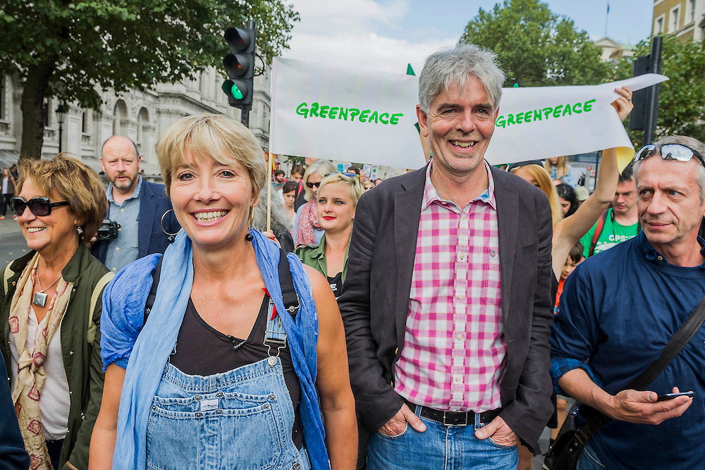 """People's Climate march, London – As part of an international day of protest - led by Emma Thompson (pictured with John Sauvin director of Greenpeace)and Vivienne Westwood - people march to demand: """"a world with an economy that works for people and the planet; a world safe from the ravages of climate change; and a world with good jobs, clean air, and healthy communities for everyone.  The march started in Temple Place and ended outside Parliament – Westminster, London, UK,  21st Sept  2014. Guy Bell, 07771 786236, guy@gbphotos.com"""