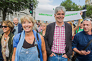 "People's Climate march, London – As part of an international day of protest - led by Emma Thompson (pictured with John Sauvin director of Greenpeace)and Vivienne Westwood - people march to demand: ""a world with an economy that works for people and the planet; a world safe from the ravages of climate change; and a world with good jobs, clean air, and healthy communities for everyone.  The march started in Temple Place and ended outside Parliament – Westminster, London, UK,  21st Sept  2014. Guy Bell, 07771 786236, guy@gbphotos.com"