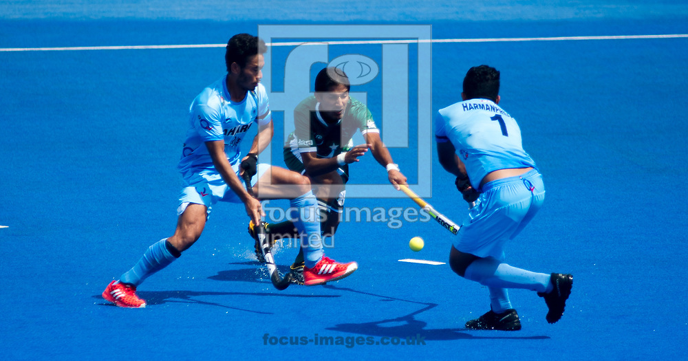 Muhammad Irfan Jr of Pakistan, Kothajit Khadangbam  and Harmanpreet Singh of India battle for the ball on day four of the Men's Hero Hockey World League Semi-Finals at Lee Valley Hockey Centre, Stratford<br /> Picture by Hannah Fountain/Focus Images Ltd 07814482222<br /> 18/06/2017