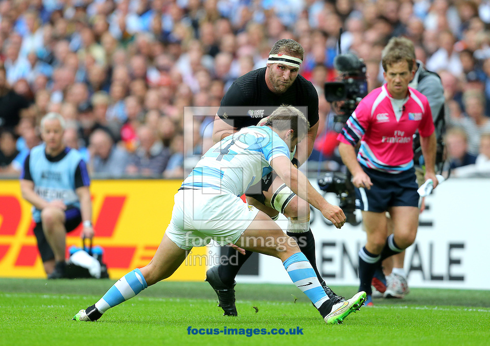 Kieran Reaf of New Zealand and Santiago Cordero of Argentina during the 2015 Rugby World Cup match at Wembley Stadium, London<br /> Picture by Paul Terry/Focus Images Ltd +44 7545 642257<br /> 20/09/2015