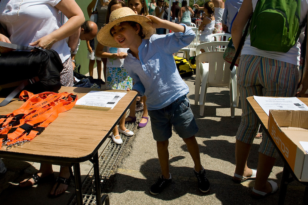 (El Puerto de Santa Maria, Spain - July 4, 2010) - On the first day of the first camp, a child peers past the welcome tables to see if he can spot any campers in the distance. ..Photo by Will Nunnally / TECS.