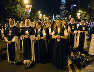 Sisters of Life from New York, New York pray while listening to Pope Francis speak on the Ben Franklin Parkway during the Festival of Families Saturday September 26, 2015 in Philadelphia, Pennsylvania. Pope Francis is expected to speak at the festival. (Photo By William Thomas Cain)