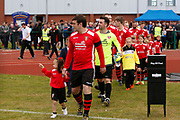 Litherland's captain Colin McDonald leads his team out for the North West Counties League Play Off Final match between Litherland REMYCA and City of Liverpool FC at Litherland Sports Park, Litherland, United Kingdom on 13 May 2017. Photo by Craig Galloway.