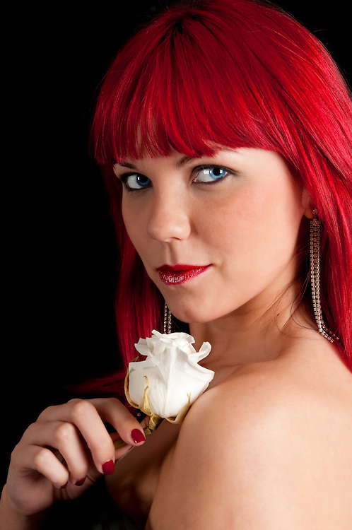 Portrait of very sensual red hair woman with rose.