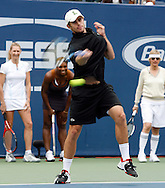 Andy Roddick takes part in a charity skills competition during 'Arthur Ashe Kids Day' before the 2006 U.S. Open at the USTA National Tennis Center in New York August 26, 2006. The U.S. Open starts on August 28. .