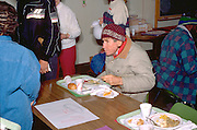 Homeless man age 52 eating at church Christmas soup kitchen.  Minneapolis Minnesota USA