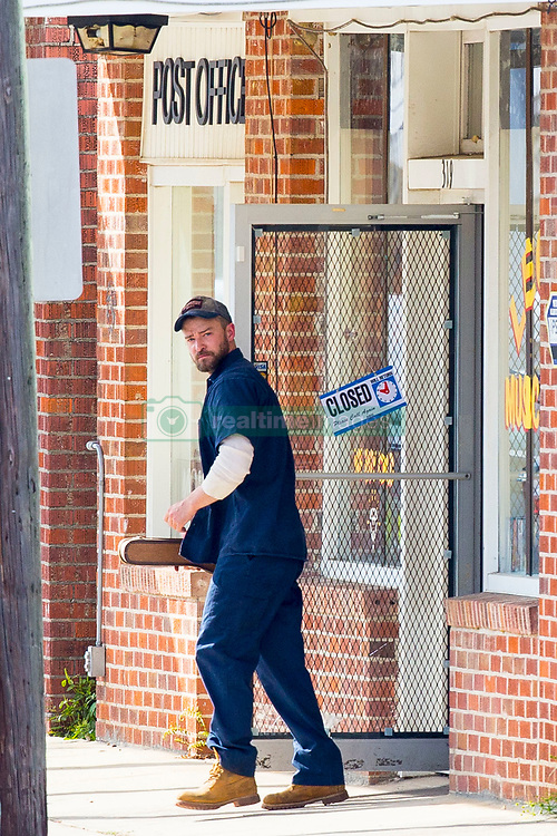 """EXCLUSIVE: Justin Timberlake takes on the role of Janitor as he starts filming for his new movie 'Palmer'. Justing could be seen, on his first day of filming, wearing overalls and a cap, with a large scar above his eye, while taking his on-screen 'step-son' to the store. He was also spotted giving acting tips to the little budding actor as they filmed their first scenes together. Justin was spotted driving a car before picking up a violin from the post office, and could also be seen being instructed by by director Fisher Stevens. In the movie, Justin is an ex high school football star, gets a scholarship to a big school, gets injured, gets addicted to pain killers. This is all backstory,"""" Fisher explains elevator pitch-style. """"Comes back home, thrown out of school and gets into a lot of trouble, tries to rob a very rich family in town, gets caught, attempted manslaughter. """"He's getting out of jail 10 years later, comes to live with his grandmother. Next door is a beautiful 30-year-old woman who's a meth addict, who has an eight-year-old boy, who likes to play with dolls and dress up as a girl in red state America. Justin's grandmother is co-parenting this boy with the meth addict mom who is always off trying to cop dope."""" Palmer,"""" written by Cheryl Guerriero, is about a former college football phenomenon who, after a stint in prison, returns to his hometown to get his life back on track. There, he faces not only lingering conflicts from his past but also a much more surprising challenge as he finds himself suddenly in charge of a unique young boy who has been abandoned by his wayward mother. 06 Nov 2019 Pictured: Justin Timberlake. Photo credit: MEGA TheMegaAgency.com +1 888 505 6342"""
