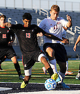 Newark Academy's Aman Patil #13 battles for the ball with Moorestown Friend's Sam Milligan #42 in the first half of the non-public B boys soccer state championship game Sunday November 15, 2015 at Kean University in Union, New Jersey. (Photo by William Thomas Cain)