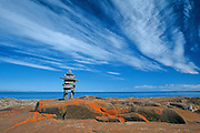 Inukshuk on rocky shore of Hudson Bay<br /> Churchill<br /> Manitoba<br /> Canada