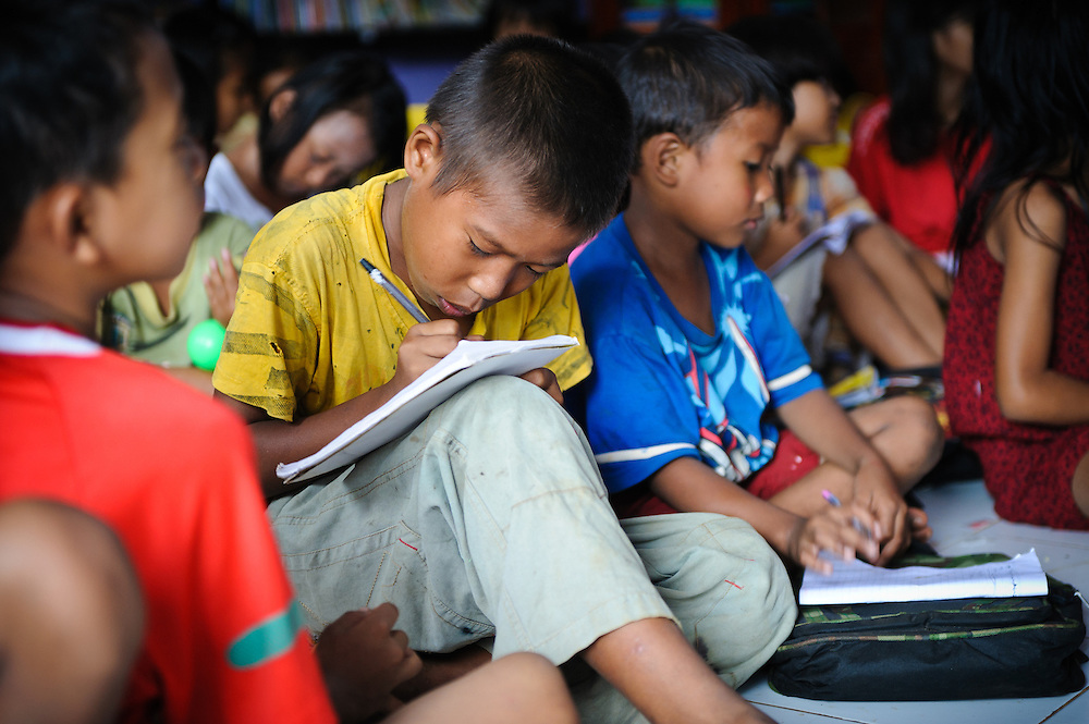 Idris, 13, in a class at the school supported by the Sacred Childhoods Foundation, Makassar, Sulawesi, Indonesia.