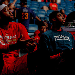 Apr 4, 2017; New Orleans, LA, USA; New Orleans Pelicans forward DeMarcus Cousins (left) and forward Anthony Davis (right) on the bench before a game against the Denver Nuggets at the Smoothie King Center. Mandatory Credit: Derick E. Hingle-USA TODAY Sports